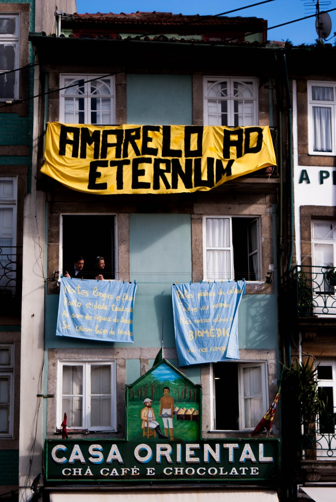 Banners on the windows of 19th century buildings in Clérigos area